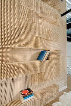 An entire childhood of Popsicle sticks made good.  Peg Wall Bookcase, Merge Architects
