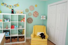 This reminds me of my nursery...complete with black wiener dog resting in chair :)