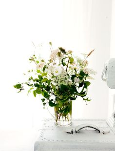 Outfit the bedside table with an arrangement of wildflowers from the meadow or roadside.