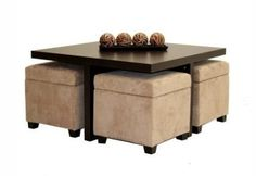 Beautiful wood coffee table with nested storage ottomans perfect for board games, children, or guests.