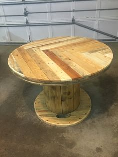 Recycled spool turned into a cafe table with a pallet wood top!