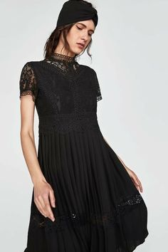 High collar dress with short sleeves. Features a seam at the waist and skirt in a contrasting pleated fabric with lace trims at the hem. Womens Navy Blue Dress, High Collar Dress, Black Lace Midi Dress, Tulip Dress, Frack, Fashion Dresses, Women's Dresses, Women's Fashion, Fashion Black