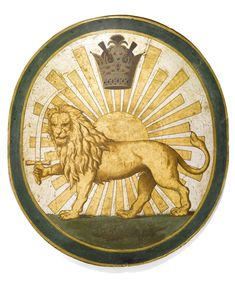A LARGE QAJAR OR PAHLAVI MILITARY EMBLEM PAINTED ON WOOD, PERSIA, CIRCA 1900; the lion is a symbol of strength, and of solar power.