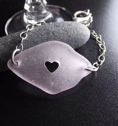 Sea Glass Jewelry - PURPLE PASSION  - Seaglass Carved Heart Bracelet.  via Etsy.