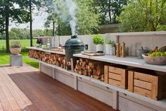 I wish this was my backyard!! Love the smoker with the mesquite or hickory logs for easy replenishing...Cam would be in heaven!!