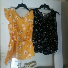 Two Banana Republic Tops Two cute tops!   Dark blue is sheer with birds designs and an elastic bottom. Yellow has ruffles down the front and a cinched elastic waist with a sash. Both only worn once. Banana Republic Tops Blouses
