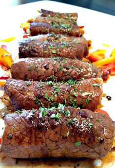 Beef Roll Ups . Delicious tender pieces of beef wrapped around cheese and veggies, and coated in a lovely Balsamic Glaze. A really quick and easy recipe too