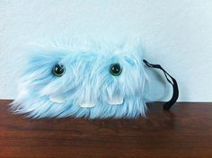 Baby Blue Monster Pocket Two Green Eyes by ShopGhoulieGirls, $22.00