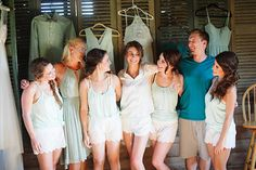 bridal party 'before' shot | Betsy Johnson bridal PJs on bride; maids (and man of honour) tanks, tee, and shorts from Old Navy  | #gettingready #weddingcandids #bestfriends | photos by April Bennett Photography @aprilbenphoto
