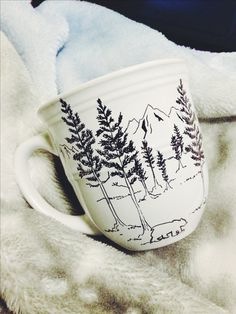 a DIY mug for a christmas gift -- happy with sendin this one to some close friends up in anchorage :) characterized by the lush sitka spruce, mountains, & our kodiak brown bear reminiscent of our hometown kodiak, alaska