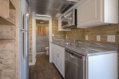 The kitchenette includes a refrigerator, combo washer/dryer unit, full-size dishwasher, and microwave