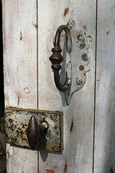 whitewash door with rusty hinge