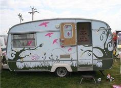 Whimsical paint on this vintage camper.