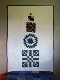 Decorating with Antique quilt blocks, appliqued onto some Kona White and quilted simply. Even the binding is antique fabric.   By Galloping Pony
