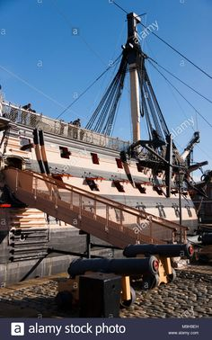 Starboard side (with gangplank ramp of stairs, & cannon) of Admiral Lord Nelson's flagship HMS Victory. Portsmouth Historic Dockyard / Dockyards UK Stock Photo: 178016233 - Alamy