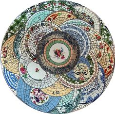 'putting the pieces together again' ~ Broken plate mosaic table top by Valerie Bourrianne, France. www.elle-mosaique.com