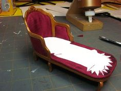 This is the project for this month. This French chaise is made from card stock, foam core and mat board. You could trim off the front of the chaise and make a chair. The chaise in front, the one wit