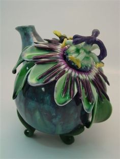 One of Donna Causland's amazing flower-inspired teapots. Passion flower, so pretty! One of Donna Causland's amazing flower-inspired teapots. Passion flower, so pretty! Ceramic Teapots, Ceramic Art, Teapots Unique, Tea Pot Set, Tea Box, Flower Tea, Teapots And Cups, Passion Flower, My Cup Of Tea