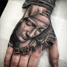 75 Inspiring Virgin Mary Tattoos Ideas & Meaning - Tattoo Me Now Hand Palm Tattoos, Cool Forearm Tattoos, Finger Tattoos, Jesus Hand Tattoo, Christ Tattoo, Jesus Tattoo Design, Skull Rose Tattoos, Skull Girl Tattoo, Cover Up Tattoos For Men