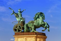 Statue representing War, a man holding a snake on a chariot, on a colonnade in Heroes Square or Hosok Tere by day, Budapest, Hungary. Famous Places, Hungary, Statue Of Liberty, Travel Photos, Fine Art America, Hold On, Hero, Canvas, Prints