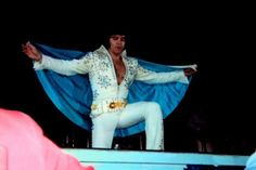Elvis wearing the 1973 Snowflake jumpsuit & cape.. Unknown location. May, 1973.