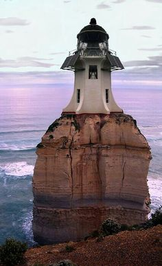 lighthouse- I don't know where it is, but I am intrigued by it! I am trying to decide if it is actually the Cape Reinga Lighthouse in New Zealand (minus the rock of course. Beacon Lighting, Beacon Of Light, Saint Mathieu, Beautiful Places, Beautiful Pictures, Wonderful Places, Lighthouse Pictures, Parasols, Light Of The World
