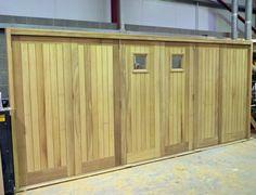 Bi-folding Garage doors made from Iroko.