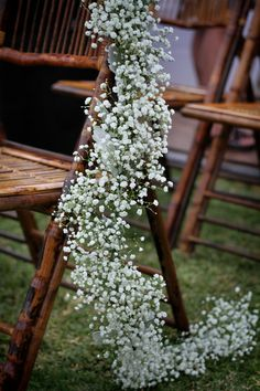 These baby's breath garlands are so simple yet so STUNNING! {Impressions Photography}