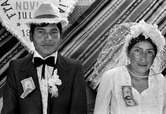 Wedding couple in the Andes, Kami, Bolivia, with good fortune money pinned to their clothes -- Photo by Ferdinando Scianna, 1986