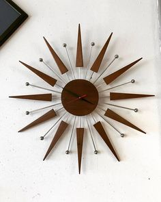 Walnut Starburst clock with metal accents. from ray to ray 1 inches thick Quartz battery operated Corner Furniture, Furniture Sale, Unique Furniture, Steel Furniture, French Furniture, Sunburst Clock, Retro Clock, Diy Clock, Clock Wall