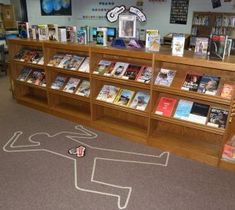 Murder in the Library!  What a great Library Display Idea for Mystery Books! Dborck.wordpress.com