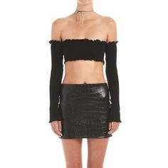 Defiant and impossibly cute. Tiiu is a dainty sleeved bandeau with lettuced edges in our signature stretch rib. Perfect with high waisted denim or our Kell leather skirt, this top is the best kind of