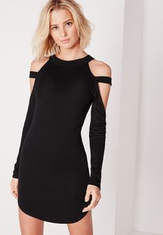 This curved hem dress is a great way to showcase your very own curves! Featuring a bodycon fit and seriously bangin' cage shoulder detailing, get it or regret it. Styled with black ankle boots and silver jewellery for a sassy vibe.