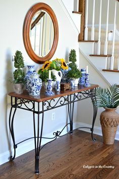 Foyer Console Table Decorated with Sunflowers and Blue and White