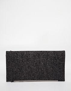 Tasche von Nali in matter Lederoptik Umschlag mit Glitzerverzierung Reißverschluss-Innentasche feiner Kettenriemen Mit feuchtem Tuch abwischen. 100% Polyurethan H: 20 cm/8 Zoll, B: 38 cm/15 Zoll, T: 2,5 cm/1 Zoll