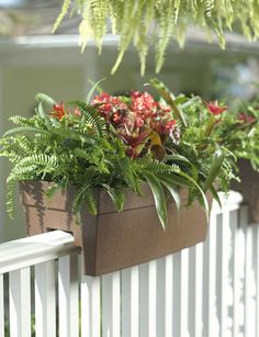 Self-Watering Railing Planter - I love the look of these planters on my deck: clean, sleek, but still traditional. And the self-watering ability is a bonus! Railing Planter Boxes, Balcony Railing Planters, Deck Railings, Outdoor Planters, Railing Flower Boxes, Planter Ideas, Porch Planter, Wicker Planter, Railing Ideas