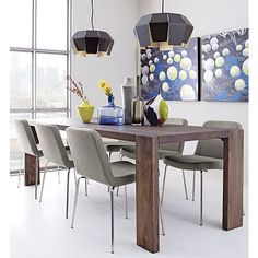 a leg up.  Plantation grown solid mango wood planks shift perspective in asymmetric wide/narrow leg rotation.  Bird's eye view from the top is stunning: sweeping woodgrain in midtone brown, inset legs create directional geometry (and dinner conversation).  XL span seats party of ten.