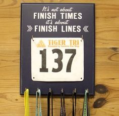 Compact race bib holder with hooks for medals - A great way to display 5k, 10k, half-marathon and marathon medals and running race bibs.