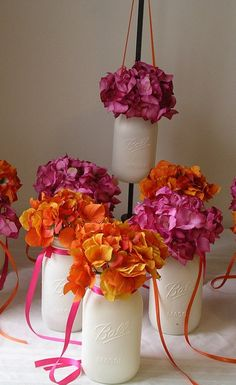 White mason jars and the pop of color is fabulous!