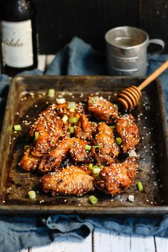 Sweet and spicy crispy baked chicken wings with honey, sriracha and soy. A secret ingredient crisps them up in the oven without having to use any flour!
