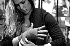 Ronda Rousey- Drop dead gorgeous former Olympian and one hell of an MMA fighter- Just became first woman to be welcomed into the UFC.