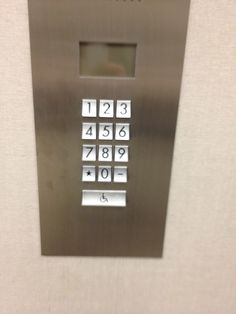 The elevator call buttons at 1 California St (SF). Not the most intuitive UI I've seen. Maybe more appropriate for, hmmm, a phone?