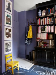 Designer David Kaihoi tricks the eye in his tiny East Village apartment with bold colors. Deep violet with pops of yellow actually enlarges the entryway. To replicate, we recommend Benjamin Moore Persian Violet. Click through for more designer paints in the best color for summer.