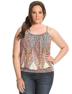 Our soft knit tank is a favorite for sunny days with an eye-catching print and braided straps. The flattering banded bottom silhouette and scoop neck show off your shape, with adjustable straps for your perfect fit. lanebryant.com
