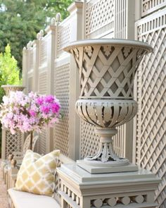 Trianon vase and pedestal in Le ­Manach's garden......I love the FENCE in the background! Gorgeous!