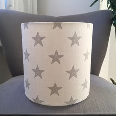 A personal favourite from my Etsy shop https://www.etsy.com/uk/listing/495172917/drum-lampshade-grey-star-fabric-shade