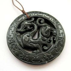Stone Carved Dragon Amulet Pendant. A dragon is a legendary creature, typically with serpentine or reptilian traits, that feature in the myths of many cultures. There are two distinct cultural traditions of dragons: the European dragon, derived from European folk traditions and ultimately...