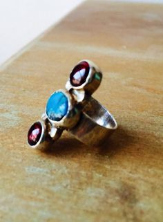 Garnet and Turquoise Ring by MilfordCalamity on Etsy https://www.etsy.com/listing/239827742/garnet-and-turquoise-ring