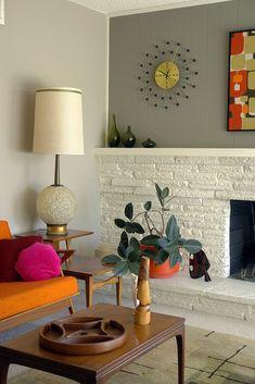 LR fireplace | Looks great in the orange planter! #retrohomedecor