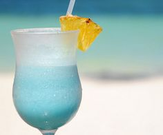 Blended Hypnotiq Margarita by Lauren Wainwright  Ingredients: 1 oz Tequila 1 oz Hypnotiq Liqueur 1/2 oz blue Curacao Juice of half a lime Fresh pineapple/Pineapple juice sugar (or salt) for rimming pineapple for garnish